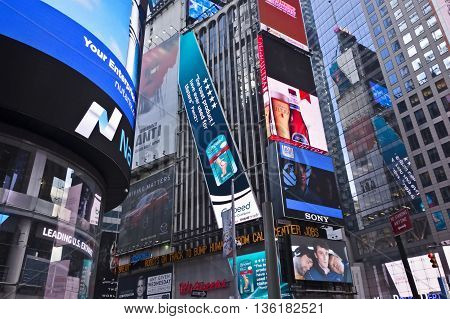 NEW YORK CITY - June 21 2016 - A sampling of colorful billboards ads and sign in New York's Time Square - MANHATTAN NEW YORK