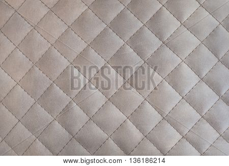Texture of genuine leather upholstered furniture. Decorative background