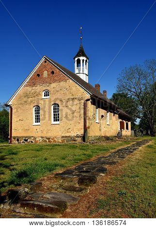 Bethabara North Carolina - April 23 2016: 1788 Gemeinhaus Moravian Church with attached minister's house at Bethabara historic settlement