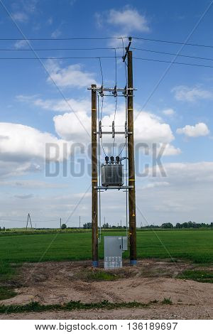 electric pole in a field with a wardrobe