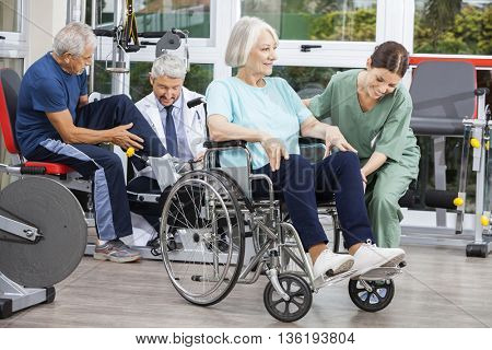 Senior People Being Assisted By Physiotherapists In Rehab Center