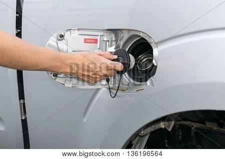 Hand opening the oil filler cap. cap, car, gas,