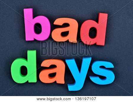 The words Bad days on black background