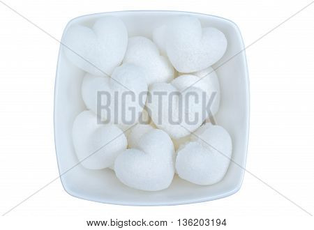 Isolated heart sugar in bowl on white background