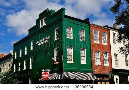 Baltimore Maryland - July 22 2013: 18th and 19th century buildings now house shops pubs and restaurants in the historic Fells Point neighbourhood