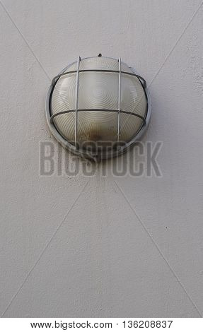 old streetlight with the cement wall background