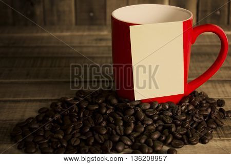 note paper and red cup coffee on wood table.