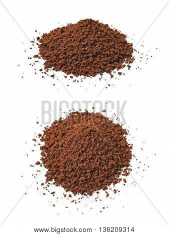 Pile of instant coffee grains isolated over the white background, set of two different foreshortenings