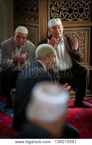 Mangalia Romania - May 27 2016: Muslims hold their Friday prayer at the mosque in Mangalia Romania.