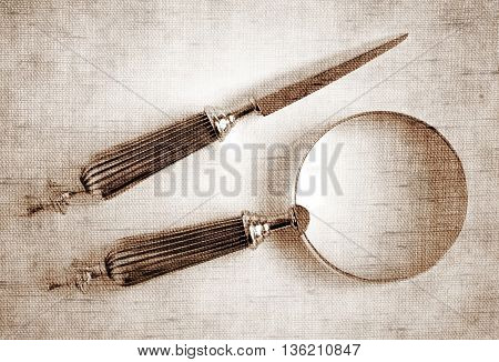 Sepia toned Antique Silver Loupe and Letter Opener - Photo made with canvas texture effect