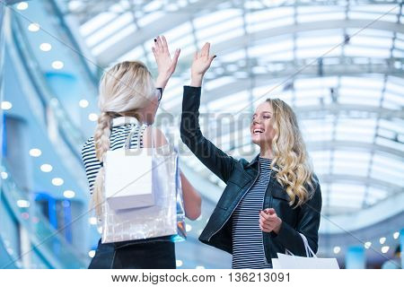 Smiling girls in a store