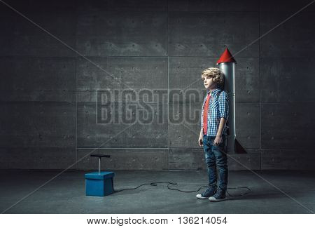 Little boy with rocket indoors