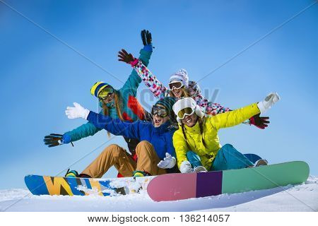 Young people with snowboards outdoors