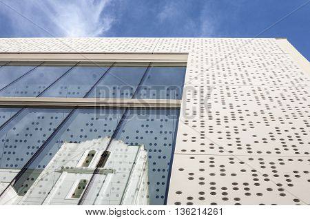 Badajoz Spain - June 19 2016: MUBA Museum building. Prestressed cement skin and perforated white with reflections