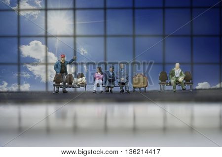 mini passenger sit and wait for airplane to take off at airport in font of window and blue sky with sun light and cloud - can use to display or montage on product