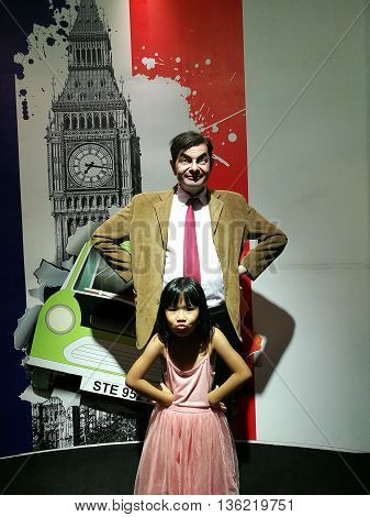 Da Nang, Vietnam - Jun 20, 2016: Mr Bean wax statue at Ba Na Hills mountain resort. Mr. Bean is a British sitcom created by Rowan Atkinson and Richard Curtis, and starring Atkinson in the title role.