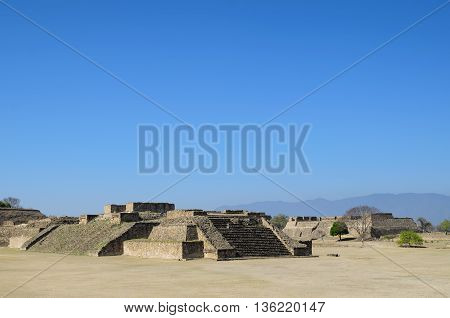 Monte Alban pyramid ruins in Mexico on a sunny day