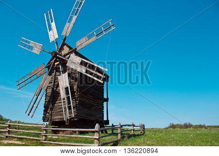 Landscape with old windmill in the village Pirogovo, Ukraine. Eastern Europe.