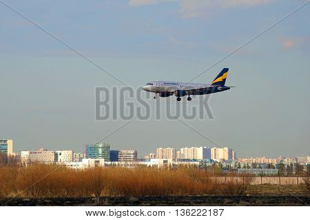 SAINT PETERSBURG, RUSSIA - APRIL 16, 2016: Airbus A319-111 VP-BNB) airlines Donavia on the final approach before landing in Pulkovo airport