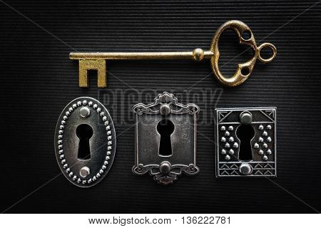 Three vintage door locks with gold key