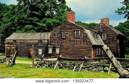 Lincoln Massachusetts - July 10 2013: A split rail fence stone walls and the historic 1732 Hartwell Tavern in Minuteman National Historic Park