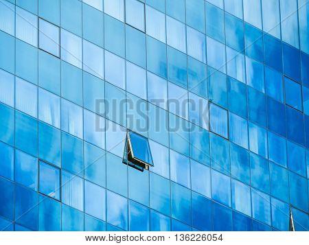 in a modern office building, a window is opened.