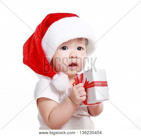 Little baby celebrates Christmas. New Year's holidays. Baby in a Christmas costume with gift
