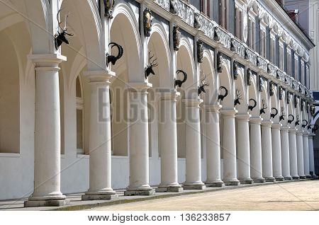 Colonnade of old Stables Courtyard with black sculptures of horned animals in perspective. Dresden Altstadt, Saxony, Germany.