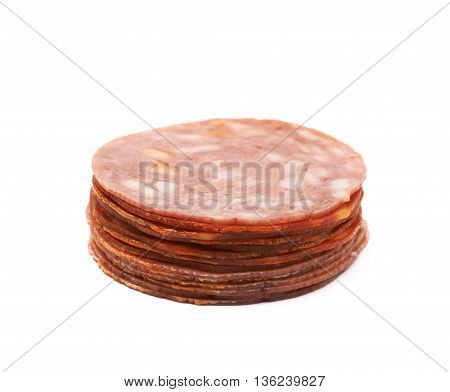 Pile of multiple Italian sausage salame napoli slices isolated over the white background