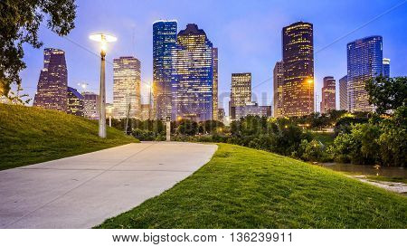 Houston city skyline as night falls and Eleanor Tinsley Park