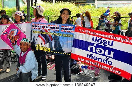Bangkok Thailand - January 13 2014: People holding anti-government sign at the Operation Shut Down Bangkok demonstration *