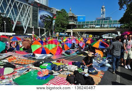 Bangkok Thailand - January 13 2014: Thanon Ratchaprasong is a sea of colourful shading umbrellas in front of Central World shopping complex on Day 1 of Operation Shut Down Bangkok *