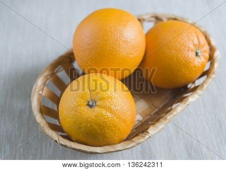 fresh oranges in the basket closeup. Healthy lifestyle.