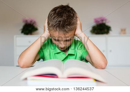 Frustrated Young Boy With Book