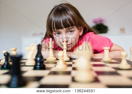 Girl And Chess Pieces