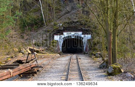 Narrow gauge tracks in mine near Karlstejn castle in spring time