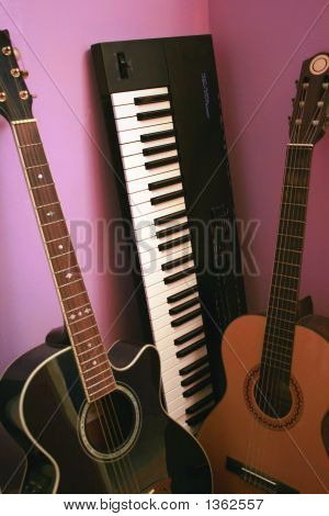Synthesizer Keyboard And Two Guitars