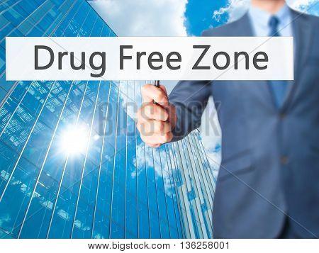 Drug Free Zone - Businessman Hand Holding Sign
