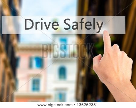 Drive Safely - Hand Pressing A Button On Blurred Background Concept On Visual Screen.
