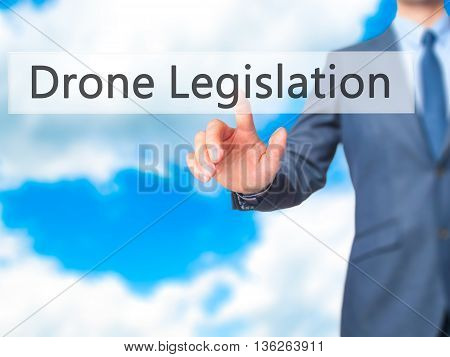 Drone Legislation - Businessman Hand Pressing Button On Touch Screen Interface.