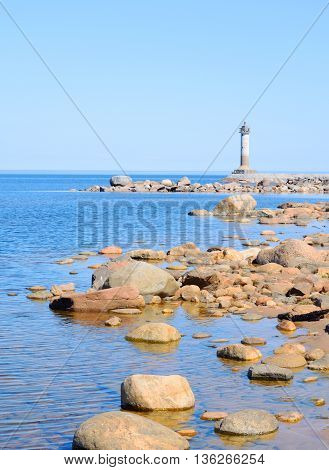 The lighthouse on the shore of Lake Ladoga at sunny morning the Karelian Isthmus.