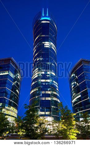 Warsaw, Poland - May 25, 2016: The Warsaw Spire is a complex of Neomodern office buildings in Warsaw, Poland constructed by the Belgian real estate developer Ghelamco. It consists of a 220-metre main tower with a hyperboloid glass facade, and two 55-metre
