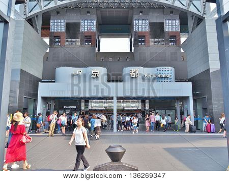 KYOTO, JAPAN - JUNE 8, 2016: Unidentified people walk around in front of main Central Gate of Kyoto Station in Kyoto, Japan. Kyoto Station is a Japan's second-largest station building.