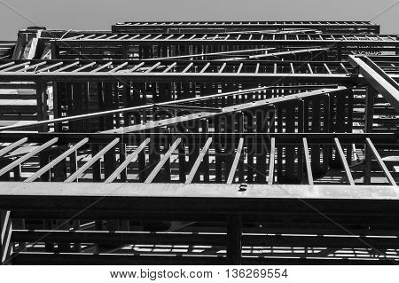 Lines and geometrical forms created by a steel balcony and fire escape ladders