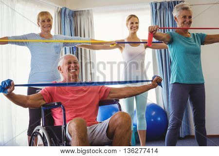 Seniors stretching during fitness class in retirement house