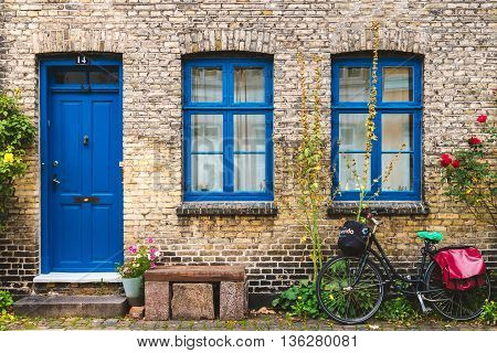 Street, Wall And Bike In Copenhagen, Denmark - September, 24Th, 2015. Blue Color Windows And Door Ne