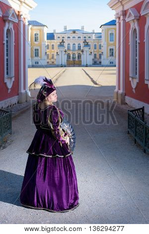 Historical cosplay. Beautiful woman in the similitude of Isabella d'Este Mantua marquess of Italian ancient dress near palace poster