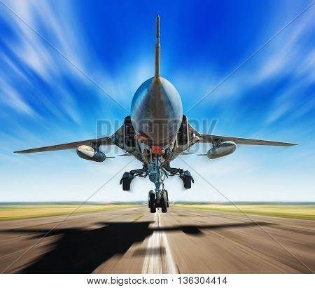 jet fighter on a runway while take off