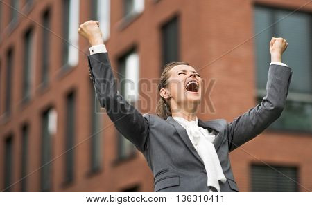 Happy Modern Business Woman Against Office Building Rejoicing