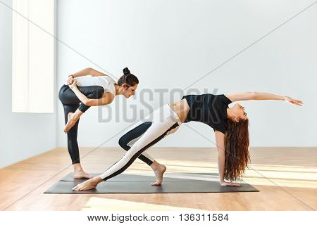 Two young women dance in the gym
